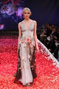 Silk rose petals creating an ombre effect at the Claire Pettibone show.